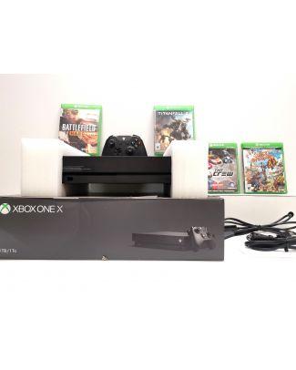 Console Xbox One X 1TB avec 4 Jeux